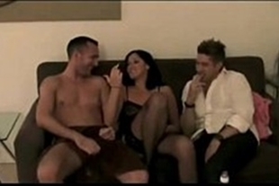 Brunette with two guys in the living room