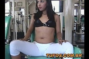 Hot brunette doing naughtiness at the gym