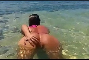 Naked teen on the beach showing her ass to her husband