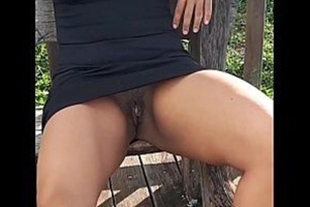 Naughty in a dress without panties in the square